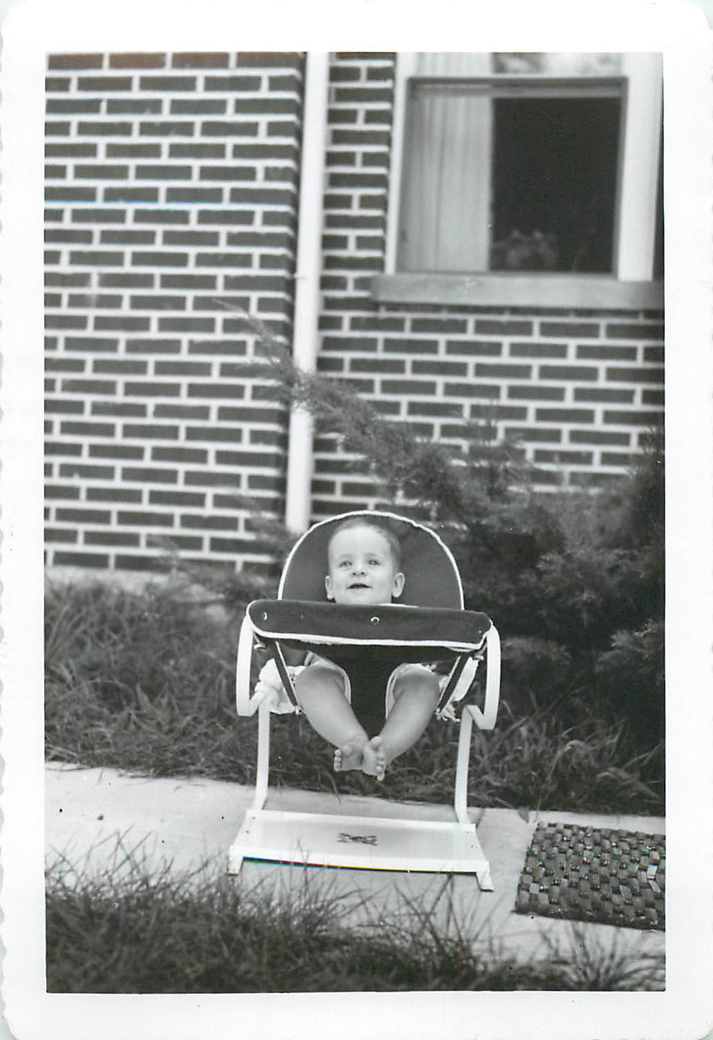 Baby Tommy in the front yard